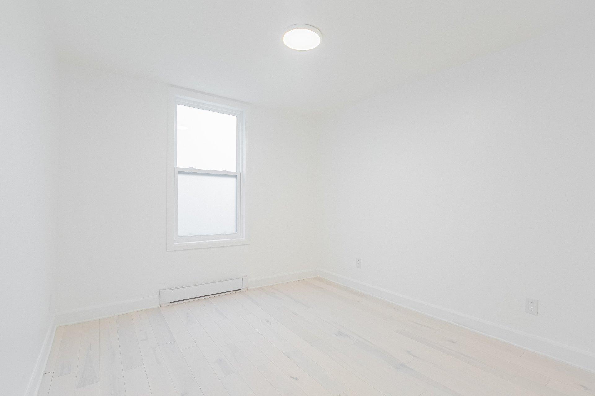 Chambre à coucher principale Triplex Montréal (Villeray/Saint-Michel/Parc-Extension)